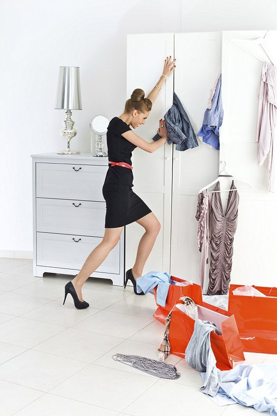 girl-closet-cleaning-kon-mari-mariekondo-fashion-Marie Kondo